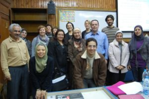 Faculty members from two universities in Egypt pose for a group photo during an instructor orientation in Cairo in January 2012.