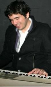 WikiCup 2011 winner Andrew Hink, playing piano