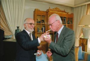King Jussein of Jordan lights P.M. Yitzhak Rabin's cigarette at royal residence in Akaba, one of the images released by the Israeli Government Press Office