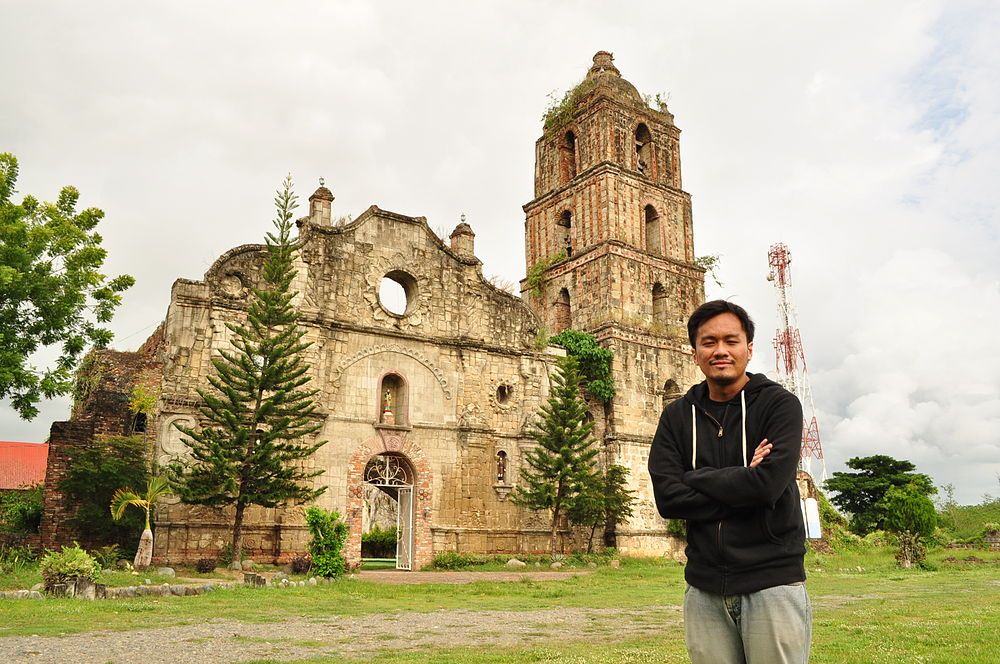 """<a href=""""https://commons.wikimedia.org/wiki/File:Portrait_of_Joel_Aldor_in_front_of_San_Pablo_Church_Ruins.JPG"""">""""Portrait of Joel Aldor in front of San Pablo Church Ruins""""</a> by <a href=""""https://commons.wikimedia.org/wiki/User:Joelaldor"""">Joelaldor</a>, under <a href=""""https://creativecommons.org/licenses/by-sa/4.0/deed.en"""">CC-BY-SA-4.0</a>"""