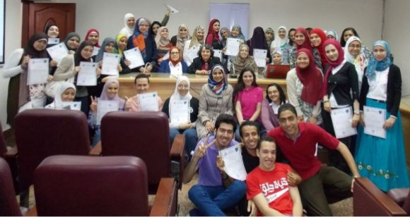 """""""Cropped group photo - Cairo 4th conference"""" by Samir I. Sharbaty, under CC-BY-SA-3.0"""