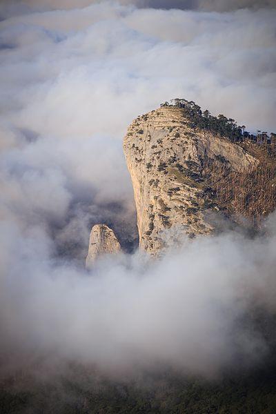"""Шаан-Кая в облаках"" by Iifar, under CC-BY-SA-3.0"
