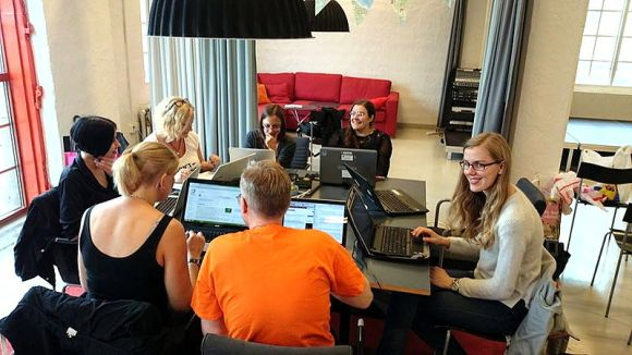 A happy group of Wikipedians gather for a weekly edit-a-thon in Gothenburg. Edit-a-thon photo by Lennart Guldbrandsson, licensed under CC-Zero