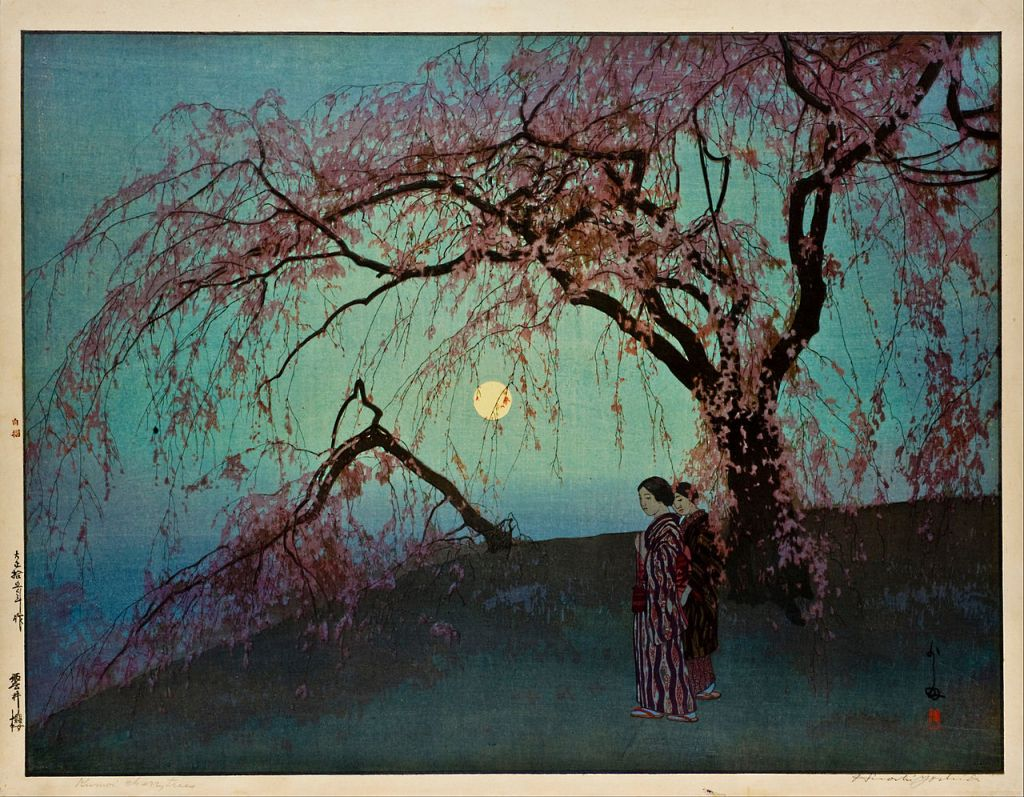 Two women in traditional Japanese dress under a cherry tree in full bloom on a grassy slope. In the background, a full moon on a cloudless night sky.