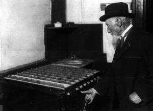 A man pushing a button on a voting machine.